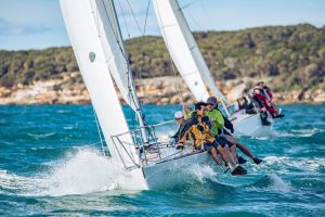 Dave West sailing ACE ppowers to windward on the saturday